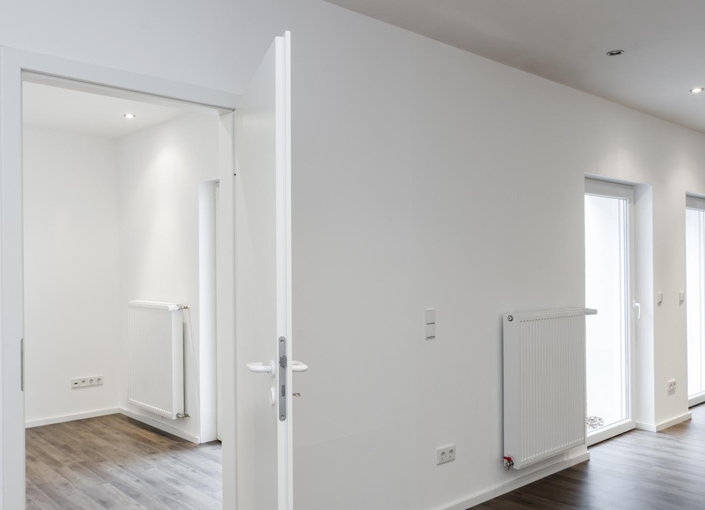 Wohnzimmer mit Zugang Arbeits-/ Gästezimmer